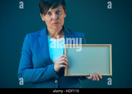 Business woman holding blank diploma certificate as mock up copy space - Stock Photo