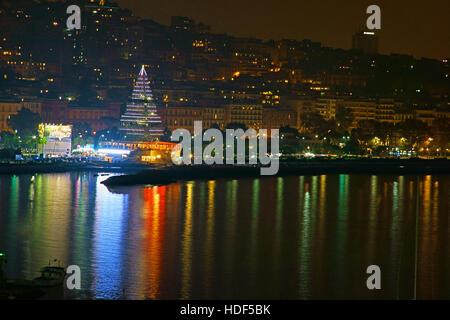 Naples, Italy, christmas 2016, building christmas tree on Via Caracciolo. christmas by night; christmas lights. - Stock Photo