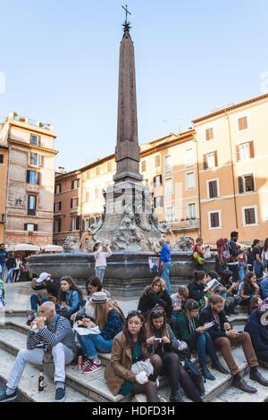 ROME, ITALY - NOVEMBER 1, 2016: tourists near fountain on Piazza della Rotonda in Rome city. Piazza della Rotonda - Stock Photo