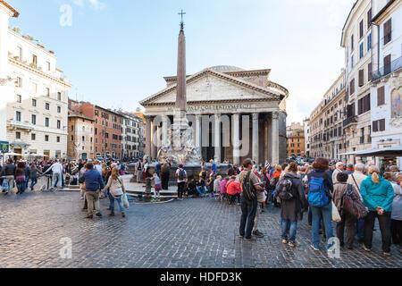 ROME, ITALY - NOVEMBER 1, 2016: tourists near Pantheon edifice on Piazza della Rotonda in Rome city. Pantheon is - Stock Photo