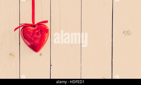 Decorative red hearts hanging on vintage wooden with space. Valentine background. - Stock Photo