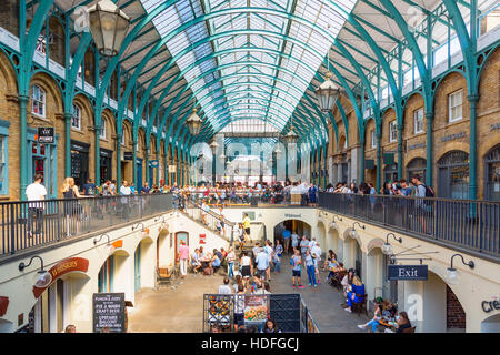 LONDON - Tourists visit the Covent Garden Market August 13, 2016 in London. One of the main London attractions, - Stock Photo