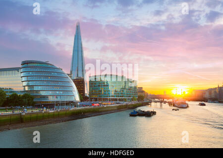 London City Hall and the Shard at sunset - Stock Photo