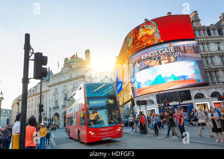LONDON - Piccadilly Circus junction crowded by people in London, UK. It's a road junction and public space of London - Stock Photo