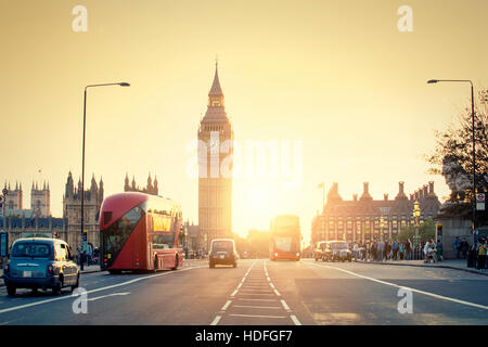 LONDON, UNITED KINGDOM,  Westminster palace and Big Ben and traffic on Westminster bridge in foreground - Stock Photo