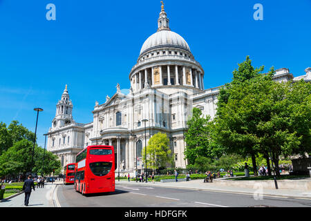 LONDON, ENGLAND  St. Paul Cathedral and red buses in London, Great Britain - Stock Photo