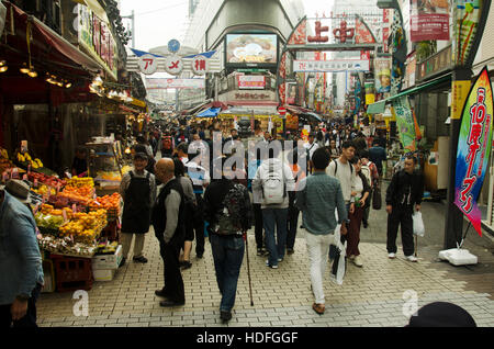 Japanese people and travelers foreigner walking and shopping on street in Ameyayokocho market at Ueno district on - Stock Photo