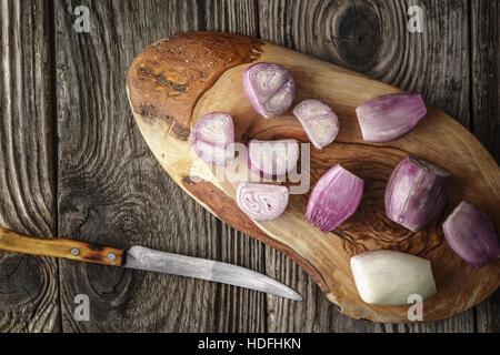 Sliced shallot on the wooden board  top view - Stock Photo