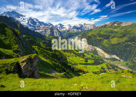 Famous Lauterbrunnen valley with gorgeous waterfall and Swiss Alps in the background from Mannlichen, Berner Oberland, - Stock Photo