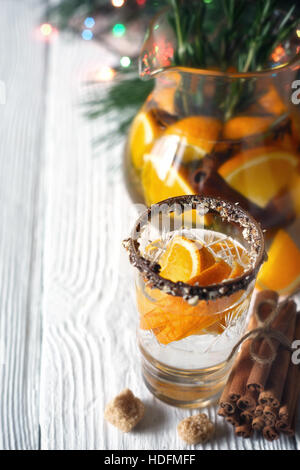 Citrus cocktail in the decorated glass on the white wooden table vertical - Stock Photo