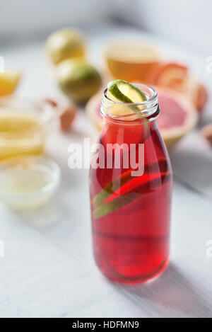 Citrus juice on the white wooden table vertical - Stock Photo