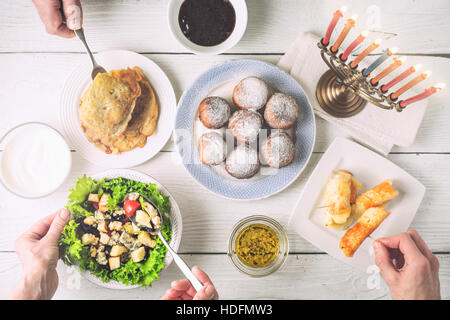 Hanukkah dinner with traditional dishes horizontal - Stock Photo