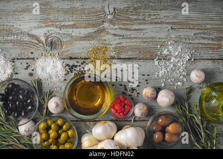 Olives with seasoning mix on the blue wooden table top view - Stock Photo