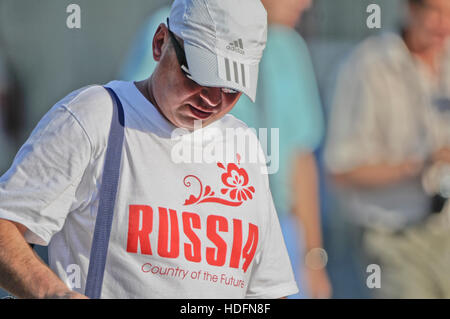 Russian sports fan wearing a t-shirt with the legend 'Russia: Country of the Future' - Stock Photo