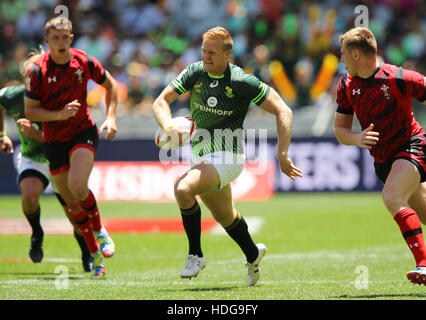 The SA Rugby Springbok Sevens players in action during the 2016 HSBC Sevens tournament at the Cape Town Stadium in Green Point Point, Cape Town. Stock Photo