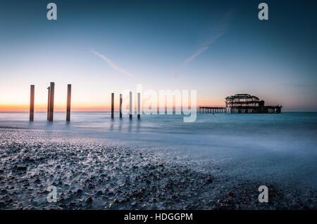 brighton west pier and beach at sunrise - Stock Photo