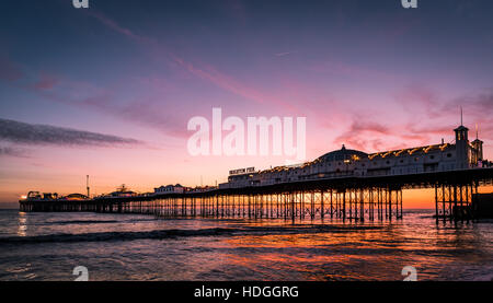 Brighton Palace Pier at sunset - Stock Photo