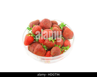 A heap of fresh strawberries in glass bowl  . Isolated - Stock Photo