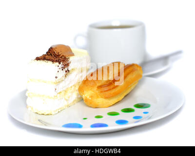Sponge cakes and eclair cake on plate with fruit juice spots. Isolated - Stock Photo
