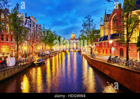 Westerkerk (Western Church), with water canal view in Amsterdam. Netherlands. - Stock Photo