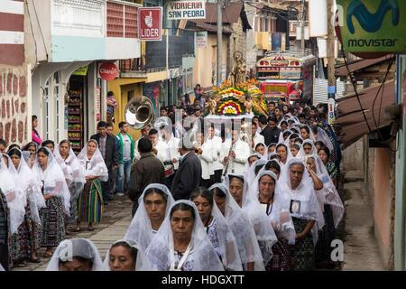 Catholic procession of the Virgin of Carmen in San Pedro la Laguna, Guatemala.  Women in traditional Mayan dress - Stock Photo