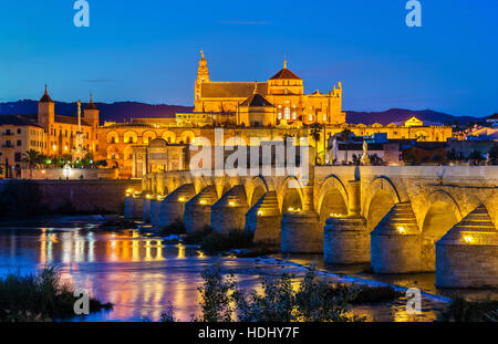 Roman Bridge across the Guadalquivir river and Mosque-Cathedral in Cordoba, Spain - Stock Photo