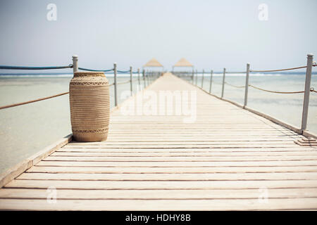 Wooden pontoon stretching into the Red sea - Stock Photo