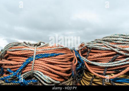 Lobster trap ropes on fishing pier, Mackerel Cove, Baily island. - Stock Photo