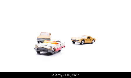 Various toy used retro toy cars isolated on white background - Stock Photo