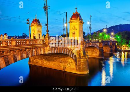 PRAGUE, CZECH REPUBLIC- SEPTEMBER 13, 2015: Beautiful view Old Bridge Legii (Most Legii) from the waterfront of - Stock Photo
