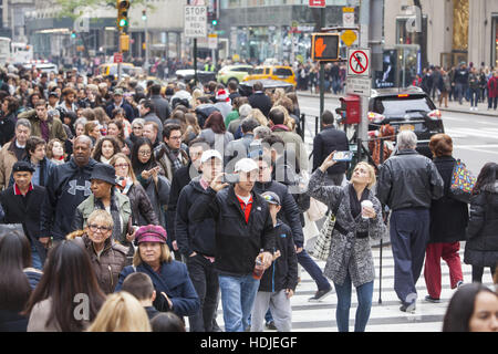 Fifth Avenue at Rockefeller Center near Saint Patrick's Cathedral is totally packed with shoppers &  tourists on - Stock Photo