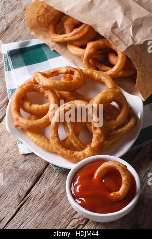 Deep fried onion rings and ketchup closeup. vertical top view - Stock Photo