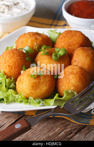 Delicious potato croquettes on a white plate close-up. vertical - Stock Photo