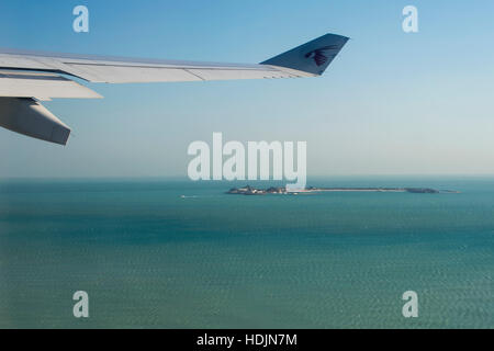 View from cabin window of a Qatar Airways flight - Stock Photo
