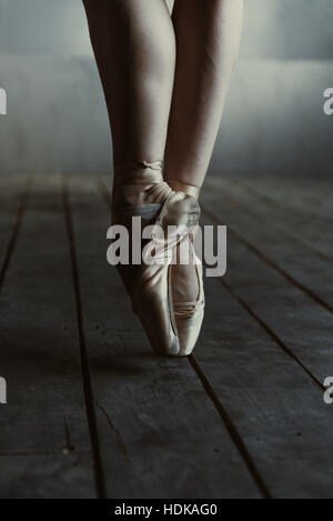 Ballet dancer legs standing on the tiptoes in pointes - Stock Photo