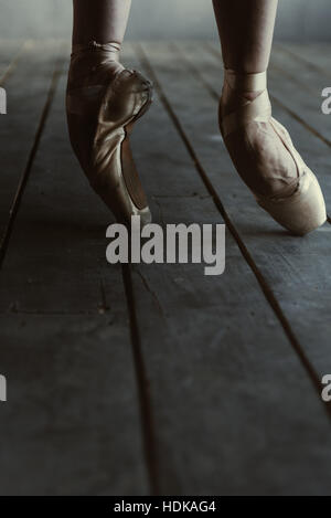 Ballet dancer standing on the tiptoes and stretching - Stock Photo