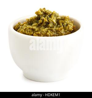 Sicilian style basil pesto in ceramic bowl isolated on white. - Stock Photo
