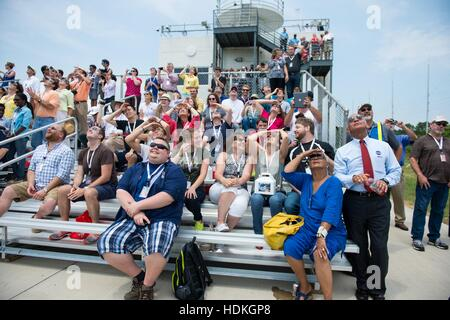 NASA Administrator Charles Bolden (right), wife Alexis Walker, and guests watch the Orbital Sciences Corporation - Stock Photo