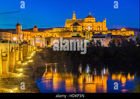 The Roman Bridge across the Guadalquivir river and the Mosque-Cathedral in Cordoba, Spain - Stock Photo