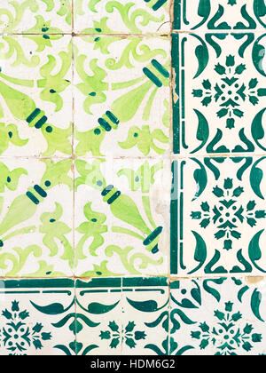 Green azulejos, old tiles in the Old Town of Lisbon, Portugal, close up. - Stock Photo