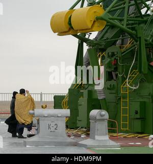 A Russian Orthodox Priest blesses the Soyuz MS-03 spacecraft rocket at the Baikonur Cosmodrome launch pad in preparation - Stock Photo