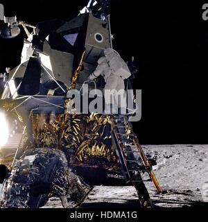 NASA Apollo 12 lunar landing mission astronaut Alan Bean climbs down the ladder of the Lunar Module Intrepid for - Stock Photo