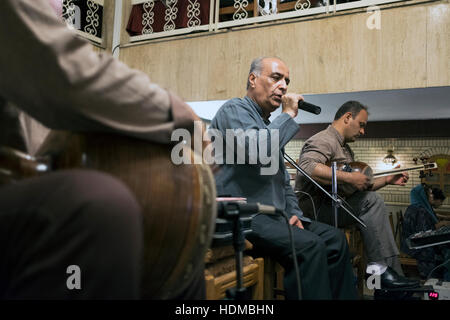 A trio of musicians play traditional Persian music in the Sharzeh Restaurant, Vakil Street, Shiraz, Fars Province, - Stock Photo