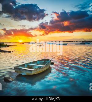 Fishing boat at sunset time.  Mauritius. - Stock Photo