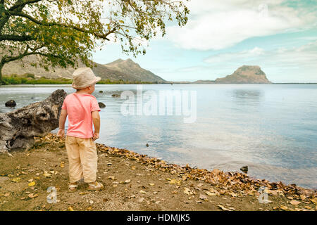 Rear view of a boy at seaside. Mauritius - Stock Photo