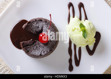 chocolate fondant with mint ice cream on a plate close-up. horizontal view from above - Stock Photo