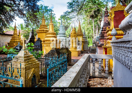 Khmer cemetery in Siem Reap, Kingdom of Cambodia. Tombs representative of ancient Buddhist temples. - Stock Photo