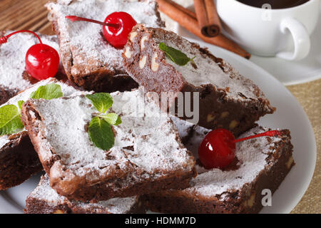 chocolate cake brownie with walnuts and coffee close-up. horizontal - Stock Photo