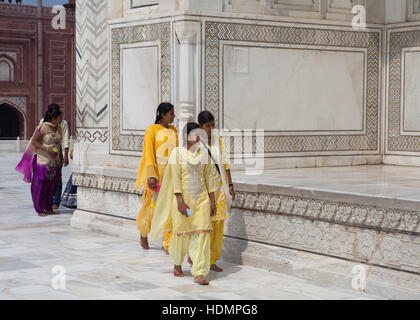 Group of local women at the Taj Mahal Mausoleum,India. - Stock Photo