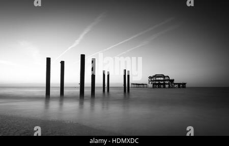 Brighton Beach and West Pier seascape in black and white - Stock Photo